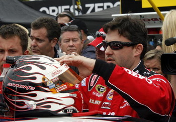 DAYTONA BEACH, FL - FEBRUARY 15:  Tony Stewart, driver of the #14 Office Depot/Old Spice Chevrolet, prepares to climb into his car prior to the NASCAR Sprint Cup Series Daytona 500 at Daytona International Speedway on February 15, 2009 in Daytona Beach, F