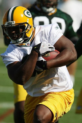 GREEN BAY, WI - JULY 28: Brandon Jackson #32 of the Green Bay Packers runs with the ball during summer training camp on July 28, 2008 at the Hutson Center in Green Bay, Wisconsin. (Photo by Jonathan Daniel/Getty Images)