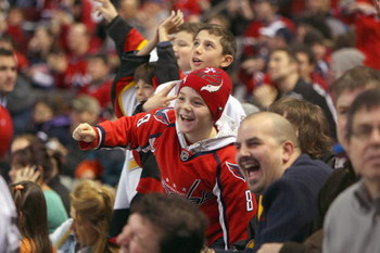 MONTREAL - JANUARY 24:  A young fan cheers during the mascot game as part of the 2009 NHL All-Star weekend on Jaunary 24, 2009 at the Bell Centre in Montreal, Canada.  (Photo by Bruce Bennett/Getty Images)