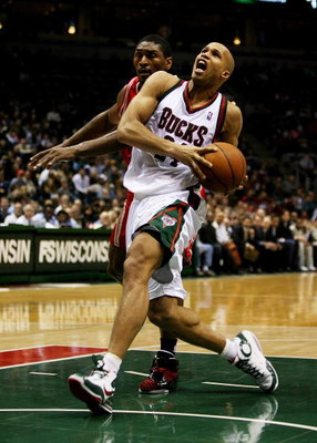 MILWAUKEE - FEBRUARY 09: Richard Jefferson #24 of the Milwaukee Bucks drives to the basket past Ron Artest #96 of the Houston Rockets on February 9, 2009 at the Bradley Center in Milwaukee, Wisconsin. The Bucks defeated the Rockets 124-112. NOTE TO USER: