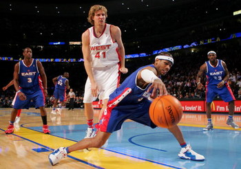 DENVER - FEBRUARY 20:   Allen Iverson #3 of the Eastern Conference All-Stars reaches for a loose ball under pressure from Dirk Nowitzki #41 of the Western Conference All-Stars during the 54th All-Star Game, part of 2005 NBA All-Star Weekend at Pepsi Cente