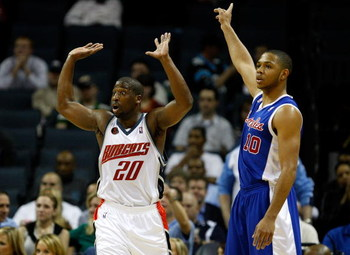 CHARLOTTE, NC - FEBRUARY 09:  Eric Gordon #10 of the Los Angeles Clippers and Raymond Felton #20 of the Charlotte Bobcats argue a call to a referee during their game at Time Warner Cable Arena on February 9, 2009 in Charlotte, North Carolina.  (Photo by S