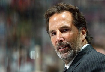 EAST RUTHERFORD, NJ - APRIL 14:  Head coach John Tortorella of the Tampa Bay Lightning watches his team against the New Jersey Devils in Game 2 of the 2007 Eastern Conference Quarterfinals on April 14, 2007 at Continental Airlines Arena in East Rutherford