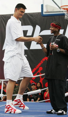 SHANGHAI, CHINA - SEPTEMBER 25:  (CHINA OUT) NBA star Allen Iverson (R) of USA and Yao Ming of China shake hands during an event at Shanghai Stadium on September 25, 2005 in Shanghai, China. Philadelphia 76ers guard Allen Iverson is visiting Shanghai as t