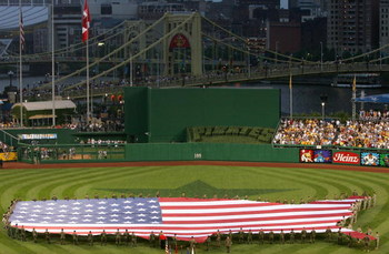 PITTSBURGH - JULY 11:  An American flag in the shape of the U.S.A. is displayed on the field before the 77th MLB All-Star Game at PNC Park on July 11, 2006 in Pittsburgh, Pennsylvania.  (Photo by Jamie Squire/Getty Images)