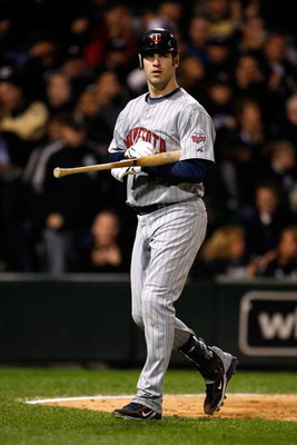 CHICAGO - SEPTEMBER 30:  Joe Mauer #7 of the Minnesota Twins walks back to the dugout after he struck out in the top of the fourth inning against the Chicago White Sox during the American League Central Division Tiebreaker game at U.S. Cellular Field on S