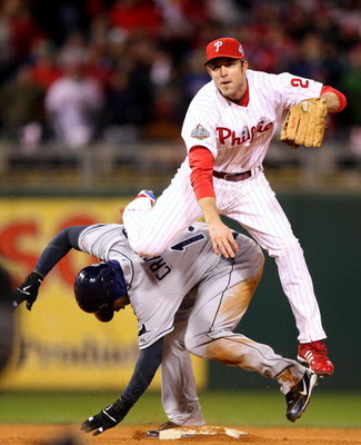 PHILADELPHIA - OCTOBER 29:  Chase Utley #26 of the Philadelphia Phillies turns a successful double play over Carl Crawford #13 of the Tampa Bay Rays on a ball hit by B.J. Upton #2 in the top of the eighth inning during the continuation of game five of the