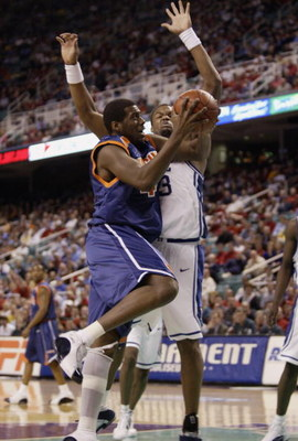 GREENSBORO, NC - MARCH 12:  Elton Brown #43 of the Virginia Cavaliers looks to shoot over Shelden Williams #23 of the Duke Blue Devils during their ACC Quarterfinal game on March 12, 2004 at the Greensboro Coliseum in Greensboro, North Carolina. The Blue