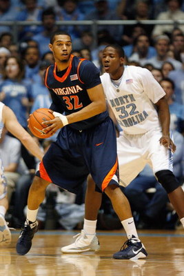 CHAPEL HILL, NC - FEBRUARY 07:  Mike Scott #32 of the Virginia Cavaliers posts up against Ed Davis #32 of the North Carolina Tar Heels on February 7, 2009 at the Dean E. Smith Center in Chapel Hill, North Carolina.  (Photo by Kevin C. Cox/Getty Images)