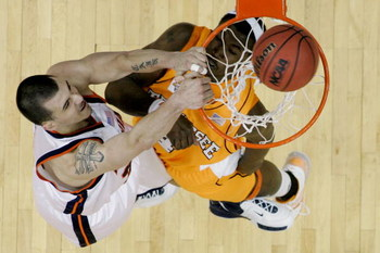 COLUMBUS, OH - MARCH 18:  Jason Cain #33 of the Virginia Cavaliers misses a dunk over Wayne Chism #4  of the Tennessee Volunteers during the second round of the NCAA Men's Basketball Tournament at Nationwide Arena on March 18, 2007 in Columbus, Ohio.  (Ph