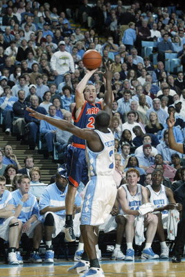 CHAPEL HILL, NC - FEBRUARY 12:  Todd Billet #22 of the University of Virginia Cavaliers shoots over Raymond Felton #2 of the University of North Carolina at Chapel Hill Tar Heels during the game at Dean E. Smith Center on February 12, 2003 in Chapel Hill,