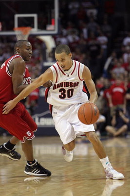 CHARLOTTE, NC - DECEMBER 6:  Stephen Curry #30 of the Davidson Wildcats drives during the game against the North Carolina State Wolfpack at Time Warner Cable Arena on December 6, 2008 in Charlotte, North Carolina. (Photo by Streeter Lecka/Getty Images)