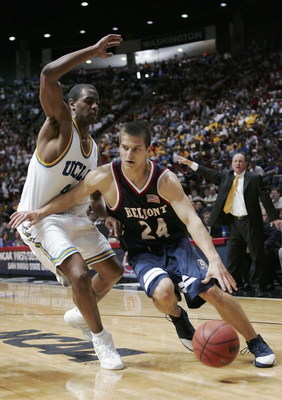 SAN DIEGO - MARCH 16:  Justin Hare #24 of the Belmont Bruins drives against Arron Afflalo #4 of the UCLA Bruins during the first round of the 2006 NCAA Men's Basketball Tournament on March 16, 2006 at Cox Arena in San Diego, California.  (Photo by Lisa Bl
