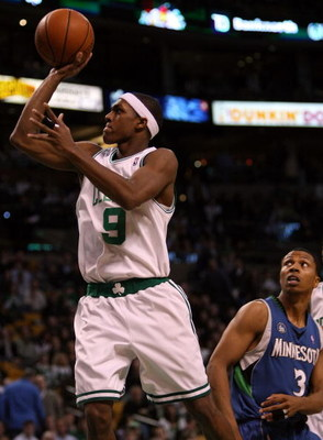 BOSTON - FEBRUARY 01:  Rajon Rondo #9 of the Boston Celtics makes the shot past Sebastian Telfair #3 of Minnesota Timberwolves on February 1, 2009 at TD Banknorth Garden in Boston, Massachusetts. The Celtics defeated the Minnesota Timberwolves 109-101. NO