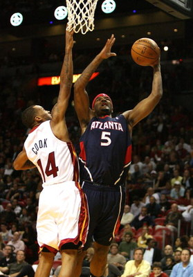 MIAMI - DECEMBER 12:  Josh Smith #5 of the Atlanta Hawks scores over Daequan Cook #14 of the Miami Heat at American Airlines Arena on December 12, 2008 in Miami, Florida. The Hawks defeated the Heat 87-73. NOTE TO USER: User expressly acknowledges and agr