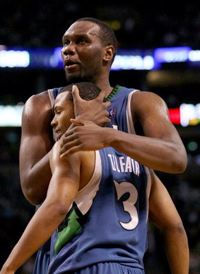 BOSTON - FEBRUARY 01:  Al Jefferson #25 and Sebastian Telfair #3 of Minnesota Timberwolves celebrate a foul called against the Boston Celtics on February 1, 2009 at TD Banknorth Garden in Boston, Massachusetts. NOTE TO USER: User expressly acknowledges an