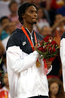 BEIJING - AUGUST 24:  Chris Bosh #12 of the United States salutes as his countries National Anthem is played during the medal ceremony after defeating Spain 118-107 in the gold medal game during Day 16 of the Beijing 2008 Olympic Games at the Beijing Olym