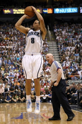 SALT LAKE CITY - MAY 16:  Deron Williams #8 of the Utah Jazz shoots a jumper while taking on the Los Angeles Lakers in Game Six of the Western Conference Semifinals during the 2008 NBA Playoffs at EnergySolutions Arena on May 16, 2008 in Salt Lake City, U