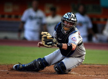 MIAMI - JULY 30:  Catcher Brian Schneider #23 of the New York Mets looks to tag a runner at home plate against the Florida Marlins in the third inning on July 30, 2008 at Dolphin Stadium in Miami, Florida.  The Marlins defeated the Mets 7-4.  (Photo by Ma