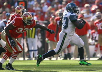 SAN FRANCISCO - OCTOBER 26:  Fullback Leonard Weaver #43 of the Seattle Seahawks outruns Michael Lewis #32 of the San Francisco 49ers for a touchdown in the third quarter at Candlestick Park on October 26, 2008 in San Francisco, California. The Seahawks d