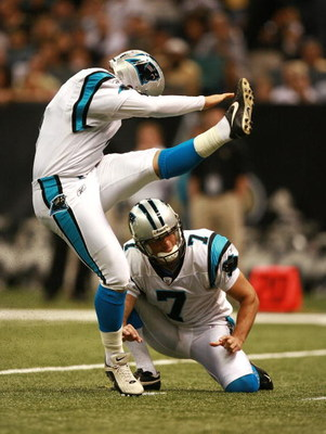 NEW ORLEANS - OCTOBER 07:  Place kicker John Kasay #4 of the Carolina Panthers kicks a field goal from under the hold of punter Jason Baker #7 while taking on the New Orleans Saints at the Superdome on October , 2007 in New Orleans, Louisiana. The Panther