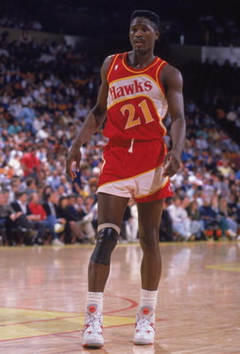 INGLEWOOD, CA - 1989:  Dominique Wilkins #21 of the Atlanta Hawks stands on the court during a NBA game against the Los Angeles Lakers at the Great Western Forum in Inglewood, California in 1989.  (Photo by Ken Levine/Getty Images)