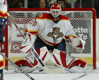 EAST RUTHERFORD, NJ - NOVEMBER 11:  Goaltender Ed Belfour #20 of the Florida Panthers prepares to make a save during their game against the New Jersey Devils at the Continental Airlines Arena on November 11, 2006 in East Rutherford, New Jersey.  (Photo by