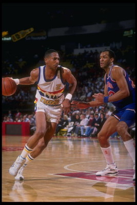 1989-1990:  Guard Alex English of the Denver Nuggets moves the ball during a game versus the Cleveland Cavaliers at the McNichols Sports Arena in Denver, Colorado. Mandatory Credit: Tim DeFrisco  /Allsport Mandatory Credit: Tim DeFrisco  /Allsport