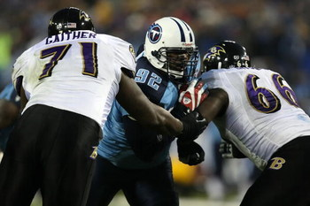 NASHVILLE, TN - JANUARY 10:  (M) Defensive tackle Albert Haynesworth #93 of the Tennessee Titans is double-teammed by lineman Jared Gaither #71 and Ben Grubbs #66 of the Baltimore Ravens during the AFC Divisional Playoff Game on January 10, 2009 at LP Fie