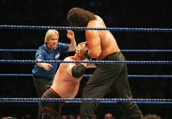 SYDNEY, AUSTRALIA - JUNE 15:  The Great Khali puts ECW Champion Kane into a vice grip during WWE Smackdown at Acer Arena on June 15, 2008 in Sydney, Australia.  (Photo by Gaye Gerard/Getty Images)