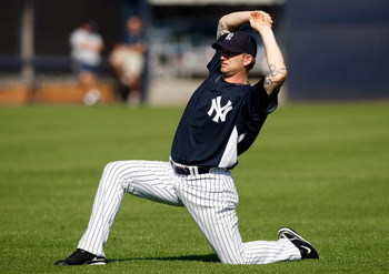 TAMPA, FL - FEBRUARY 14:  Pitcher A.J. Burnett #34 of the New York Yankees stretches during a Spring Training workout at the George M. Steinbrenner Field on February 14, 2009 in Tampa, Florida.  (Photo by J. Meric/Getty Images)