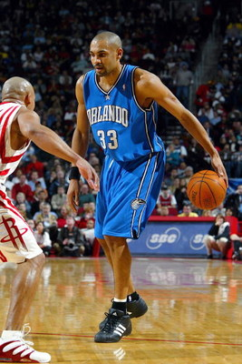 DALLAS - JANUARY 24:  Grant Hill #33 of the Orlando Magic dribbles during a game against the Houston Rockets on January 24, 2005 at the Toyota Center in Houston, Texas. The Rockets defeated the Magic 89-78.  NOTE TO USER:User expressly acknowleges and agr