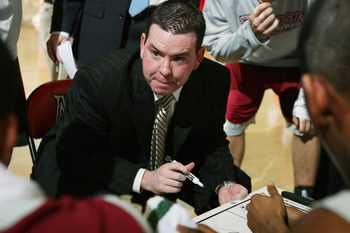 NORTHRIDGE, CA - FEBRUARY 23:  Head coach Tommy Dempsey of the Rider Broncos talks to his team during a timout in the game against the Cal State Northridge Matadors on February 23, 2008 at the Matadome in Northridge, California.  Rider won 73-72.  (Photo