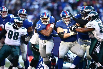 EAST RUTHERFORD, NJ -  JANUARY 11:  Brandon Jacobs #27 of the New York Giants runs the ball against the Philadelphia Eagles during the NFC Divisional Playoff Game on January 11, 2009 at Giants Stadium in East Rutherford, New Jersey.  The Eagles defeated t
