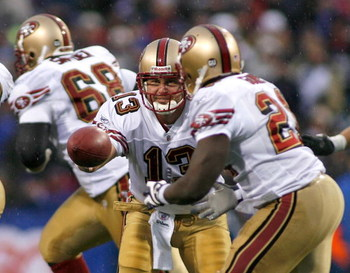 ORCHARD PARK, NY - NOVEMBER 30: Shaun Hill #13 of the San Francisco 49ers hands off to Frank Gore #21 against the Buffalo Bills   on November 30, 2008 at Ralph Wilson Stadium in Orchard Park, New York.  The 49ers won10-3.  (Photo by Rick Stewart/Getty Ima