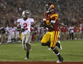 LOS ANGELES, CA - SEPTEMBER 13:  Damian Williams #18 of the USC Trojans scores a touchdown against the Ohio State Buckeyes in the college football game at Los Angeles Memorial Coliseum on September 13, 2008 in Los Angeles, California. The Trojans defeated