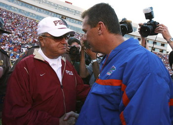 TALLAHASSEE, FL - NOVEMBER 25:  Head coach Bobby Bowden of the Florida State Seminoles congratulates head coach Urban Meyer of the Florida Gators after the Gators' victory at Doak Campbell Stadium November 25, 2006 in Tallahassee, Florida. Florida defeate