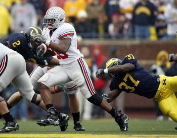 ANN ARBOR, MI - NOVEMBER 17:  Chris Wells #28 of the Ohio State Buckeyes runs past Chris Graham #37 of the Michigan Wolverines on November 17, 2007 at Michigan Stadium in Ann Arbor, Michigan.  (Photo by Gregory Shamus/Getty Images)