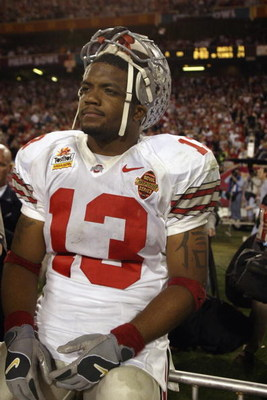 TEMPE, AZ - JANUARY 3:  Freshman running back Maurice Clarett #13 of the Ohio State Buckeyes takes in the BCS Championship victory over the University of Miami Hurricanes in the Tostitos Fiesta Bowl at Sun Devil Stadium on January 3, 2003  in Tempe, Arizo