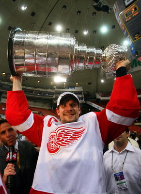 PITTSBURGH - JUNE 04: Nicklas Lidstrom #5 of the Detroit Red Wings celebrates with the Stanley Cup after defeating the Pittsburgh Penguins in game six of the 2008 NHL Stanley Cup Finals at Mellon Arena on June 4, 2008 in Pittsburgh. Pennsylvania. The Red