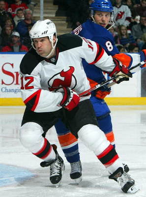 UNIONDALE, NY - FEBRUARY 21:  Brian Rolston #12 of the New Jersey Devils skates against the New York Islanders on February 21, 2009 at Nassau Coliseum in Uniondale, New York. The Isles shutout the Devils 4-0.  (Photo by Jim McIsaac/Getty Images)