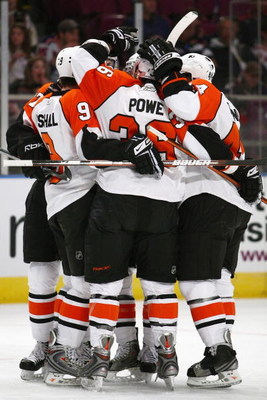 NEW YORK - FEBRUARY 15:  The Philadelphia Flyers celebrate on the ice during the game against the New York Rangers on February 15, 2009 at Madison Square Garden in New York City.  (Photo by Chris McGrath/Getty Images)