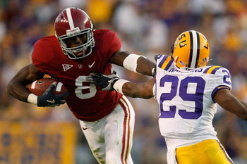 BATON ROUGE, LA - NOVEMBER 08:  Julio Jones #8 of the Alabama Crimson Tide avoids a tackle by Chris Hawkins #29 of the Louisiana State University Tigers  on November 11, 2008 at Tiger Stadium in Baton Rouge, Louisiana. The Tide defeated the Tigers 27-21 i