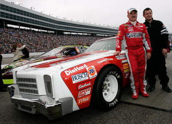FORT WORTH, TX - NOVEMBER 05:  Terry Labonte, driver of the #44 Kellogg's Chevrolet and his son Justin pose for a photo next to a replica of Terry's first race car prior to the NASCAR Nextel Cup Series Dickies 500, on November 5, 2006 at Texas Motor Speed