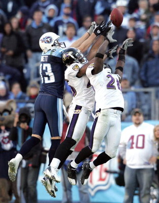 NASHVILLE, TN - NOVEMBER 12:  (L-R) Drew Bennett #83 of the Tennessee Titans, Dawan Landry #26 and Ed Reed #20 (R) of the Baltimore Ravens reach for a pass intended for Bennett during the NFL game on November 12, 2006 at LP Field in Nashville, Tennessee.