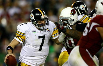 TAMPA, FL - FEBRUARY 01:  Quarterback Ben Roethlisberger #7 of the Pittsburgh Steelers looks to avoid getting sacked by tackle Darnell Dockett #90 of the Arizona Cardinals during Super Bowl XLIII on February 1, 2009 at Raymond James Stadium in Tampa, Flor