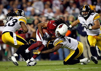 TAMPA, FL - FEBRUARY 01:  Larry Fitzgerald #11 of the Arizona Cardinals makes a reception against the Pittsburgh Steelers during Super Bowl XLIII on February 1, 2009 at Raymond James Stadium in Tampa, Florida.  (Photo by Streeter Lecka/Getty Images)