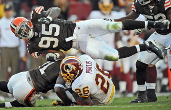 LANDOVER, MD - OCTOBER 19: Linebacker Kamerion Wimbley #95 of the Cleveland Browns takes to the air over running back Clinton Portis #26 of the Washington Redskin on October 19, 2008 at FedEx Field in Landover, Maryland. (Photo by Drew Hallowell/Getty Ima