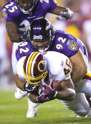 LANDOVER, MD - AUGUST 31:  Baltimore Ravens Haloti Ngata #92 tackles Washington Redskins Ladell Betts #46 during the Washington Redskins vs. Baltimore Ravens game at FedEx Field August 31, 2006 in Landover, Maryland.  (Photo by Brendan Smialowski/Getty Im