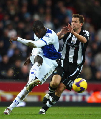 BLACKBURN, UNITED KINGDOM - JANUARY 17: Christopher Samba of Blackburn clears from Michael Owen of Newcastle during the Barclays Premier League match between Blackburn Rovers and Newcastle United at Ewood Park on January 17, 2009 in Blackburn, England.  (